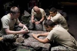 Passing the time, grunts compare manicure results.