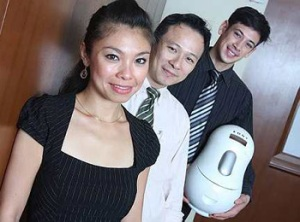 The marketing team behind the soya bean machine is all smiles.