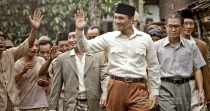 The Soekarno smile for a hot chick somewhere in the crowd...